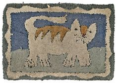 Hooked rug of a cat, 20th c., with a double bor : Lot 333