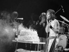 Jagger's 29th birthday (cake) on stage during the 1972 No. American tour...often referred to as the S.T.P. Tour  (for Stones Touring Party).