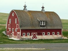 A Bow or Gothic Roof is being used in this Barn design which could be under the Category of a Dutch Style. This isn't the Typical Barn Roof but it Does work for the Overall Structure. Farm Barn, Old Farm, Agriculture, Farming, Ship Bottom, Country Barns, Country Life, Country Roads, Barn Pictures
