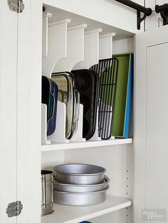 Stop stacking your pans in the drawer under the oven! Cookie sheets casserole dishes and cutting boards are more easily accessed when stored on their sides rather than stacked. This vertical sorting style allows you to see everything at once. No more di Kitchen Organization Pantry, Diy Kitchen Storage, Kitchen Pantry, New Kitchen, Home Organization, Kitchen Cabinets, Kitchen Ideas, Organizing Ideas, Kitchen Decor