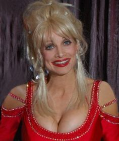 Dolly Parton bra size gained even more hype when it was found that she insured her breasts for $600,000!