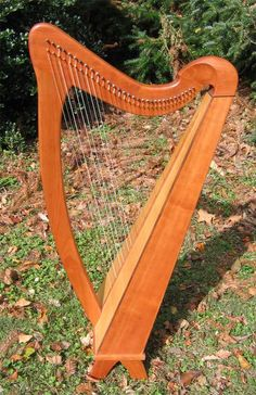 This James Jones 32 String Folk Harp has a Cherry body with a Spruce soundboard and Bocote trim