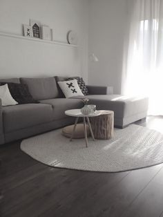 Grey lounge room. I like the coffee table teamed with the wooden stool and big…
