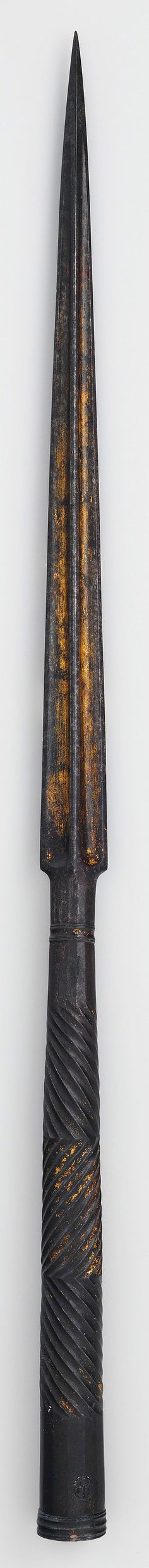 Syrian or Egyptian lance head, 16th century. The skillfully chiseled fluting patterns on the socket of this lance head are characteristic of Mamluk iron work and can be seen on Mamluk ax and mace shafts, and other lance heads. The long lance was one of the prime weapons of Mamluk cavalrymen. Met Museum.