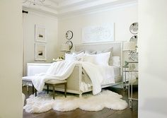 3 Luxurious tips for cozying up your master bedroom for fall, add luxurious bedding, candles and fresh flowers for the coziest fall bedroom. elegant-taupe-and-white-master-bedroom