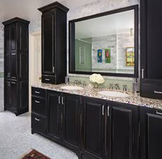 The Recycled glass counter-top, Jay Rambo Maple with Burnished Black finish cabinets and Crystal hardware fit perfectly in this bathroom remodel.