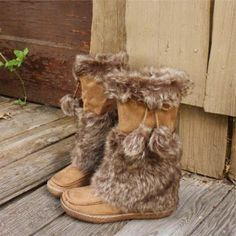 Cozy faux fur adorns these darling moccasin boots. A soft chestnut toned base is adorned with faux fur detailing, pom pom designs and a rubber bottom for the perfect fall and winter boot.Side zipper closure and cozyfit.