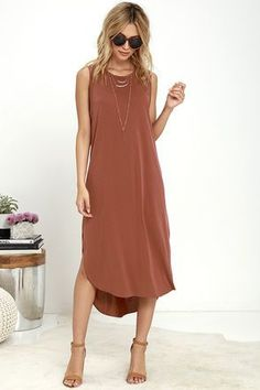 From sunrise to nightfall, you'll love how easy it is to wear the Midnight Lady Washed Red Midi Dress! Jersey knit is light and breezy across the rounded neckline that tops a sleeveless cut with relaxed arm openings. The shift bodice casually flows to a rounded midi skirt finished with a high-low hem. ##womensfashion#dresses#borntowear#outfits