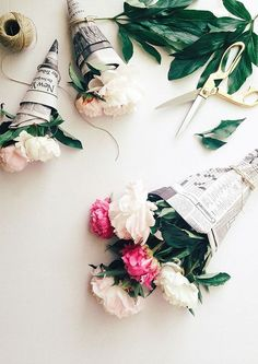 Cute idea for a gift: Wrap gorgeous flowers in old newspapers.