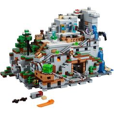 2863 Piece - Features a minecart track with an integrated redstone-powered minecart elevator; 2 minecarts; first-night shelter with bed, crafting table and torch; a mountaintop shelter with bed, torch, and furnace. Measures over 12in (31cm) high, 20in (53cm) wide and 11in (29cm) deep.