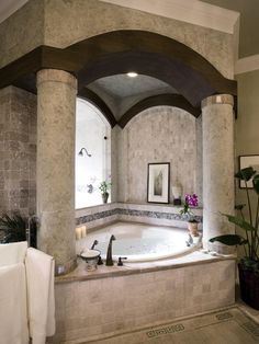 Now there's a tub and enclosure. Give it Tuscan/Mediterranean elements and colors and I'd be happy!