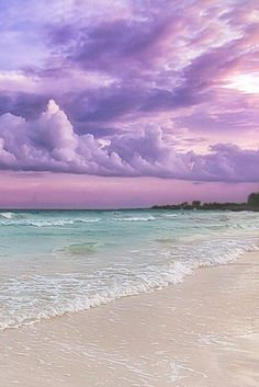 lavender sky over pale aqua sea