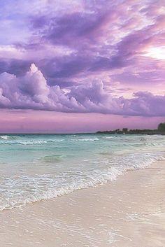 lavender sky over pale aqua sea