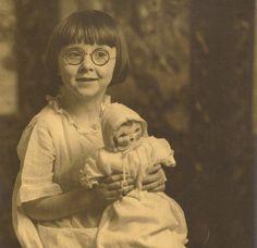 Studio photo of sweet girl holding sweet doll. 1920's?