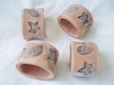 earthy handmade napkin rings with little leaf patterns from Mozak Na Pasi Ceramics | Balnarring, Australia