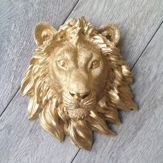 Resin lion head wall mount. Great unique wall art to add to your home or creative work space. This piece will definitely turn heads! Makes for an outstanding focal piece for a gallery wall too! Keepin it Animal Friendly & Cruelty Free! See the Dilan in other colors: https://etsy.com/shop/KINGFOUR/search?search_query=Dilan See the large Dilan: https://www.etsy.com/listing/237765104/the-dilan-in-gold-lion-head-wall-mount Feel free to customize your KingFour faux taxidermy with any color and...