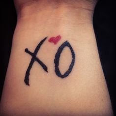 Hugs and kisses...cute tattoo, possibly an idea for matching tattoos for me and my girls...smaller though.