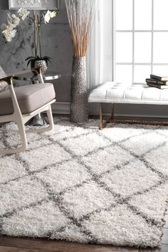 Bring a relaxed look to your décor with Bermuda easy shag rug, which is geometric patterned and machine made with 100 percent polypropylene. An amazing combination of great color as well as quality, it will add the perfect contemporary dimension to your living room area.