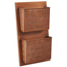 Add stylish storage to your home or office with this 2 Slot Fleur-de-lis Wall Shelf. It's shelf hangs on the wall for space saving storage in an entry, hall, mud room or office. This fun cross hatch pattern, along with the versatile copper finish allows the piece to easily complement a variety of design styles.