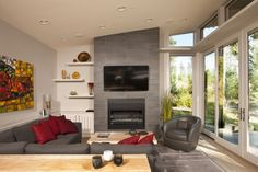 Stillwater Dwellings sd134 showing living room with fireplace, high ceilings and walls of glass.