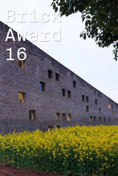 #WienerbergerBrickAward 2016 nominee 1: Song Feng Cui, China by Imagine Architects, China. In order to smoothly embed the 160 metre long factory into its surroundings, the architects decided to have it folded in a z-shape. The main materials are re-used bricks, old roof tiles and door leafs.  Photographer: Zeng Jianghe