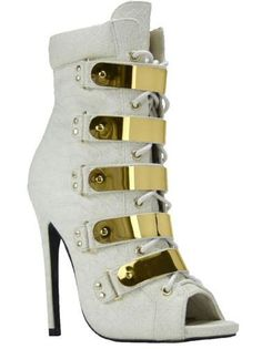 """These Booties are definitely """"ON FLEEK"""". Ivory Snake emboss leatherette lace-up Bootie with inside zipper closure. Features 5 real metal shield ornaments, gold eyelets, and metal lace tips. Available in Red, Ivory and Multi Print 