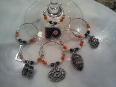 Philadelphia Flyers  Hockey wine charms w/pouch by pchum on Etsy, $27.00 What a fun project.  I think I'll try making a few of these.