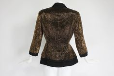 Pierre Balmain Haute Couture Iridescent Bugle Beaded Peplum Jacket tiered peplum silhouette, three-quarter length sleeves, and an open collar. Luxurious wool is covered in iridescent, rich brown bugle beads. The front zipper is hidden with hook and eye closures.