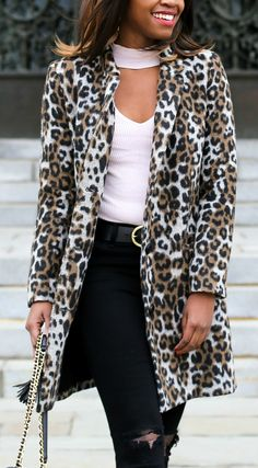 leopard coat, light pink collared top, and black destroyed denim