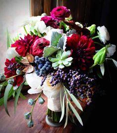 Designed by Bare Root Flora. Textured bridal bouquet, dahlia, succulents, privet berries, ranunculus, dusty miller, parrot tulips
