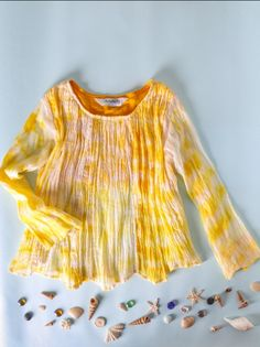 This Hand Crushed Mulmul Blouse in Tie n Dye is perfect to have your little one brighten up a dreary day! There;s something about anything tie n dye - it has a touch of unique and natural beauty. Add to that the hand crushed effect and you have winner! Crafted in comfortable mulmul, this is the ultimate addition to your young girl's wardrobe. #kids #clothing