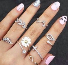 nail polish light pink jewels rings cute ring flower cross leaves nature fashion beautiful daisy sunflower ring mid finger rings leaf ring bling nails silver stylish finger style fingers ring set want it!!!! silver rings silver midi rings cross ring pink jewelry girly jewerly