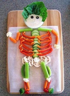 This vegetable skeleton covers just about every veggie you could ever want on a veggie tray! I love how the head is the dip bowl, too.