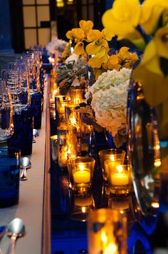 Gorgeous tulips, hydrangea, dusty miller and calla lilies line long banquet tables.