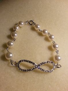 blingy infinity bracelet with off white pearls-$15