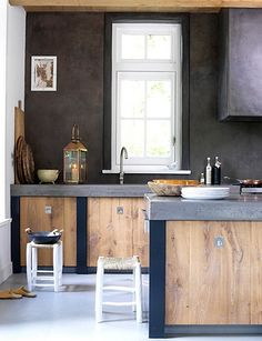 cement countertop, light wood cabinets