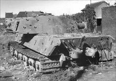 A long abandoned King Tiger that has been stripped of many parts while resting in an open field