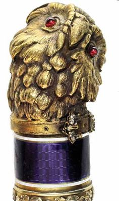 Faberge Style Dress Cane 20th Century-A cased Russian ruby, diamond and enamel handle in the shape of an owl, done in the style of Faberge. The handle is marked as if it were made by the great Russian maker but it is an aftermarket work which almost meets the standards and is falsely signed by a Faberge maker, five piece segmented ivory shaft with a black horn ferrule, fitted case. Many people have these canes in their collections and think they are real and have paid five figures. They are… Wooden Walking Sticks, Walking Sticks And Canes, Cannes, Gentleman Hat, Raising Canes, Famous Jewelers, Cane Handles, Cane Stick, Wooden Canes