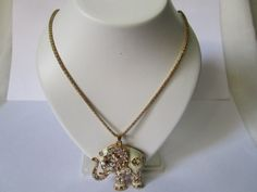 Gold plated chain with diamond studded elephant pendant.