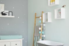 Baby room with gray background and white stars plus mint touch