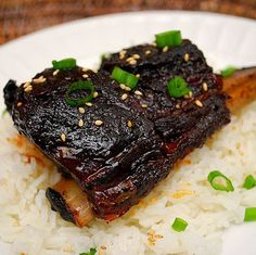 Korean Style Short Ribs braised in a Crockpot:    1 cup soy sauce   1 cup packed light brown sugar  4 tablespoons sesame oil  4 tablespoons rice vinegar  4 tablespoons minced fresh ginger  I head of garlic, peeled and minced  1 teaspoon red pepper flakes  5 lbs beef short ribs, uncut whole ribs