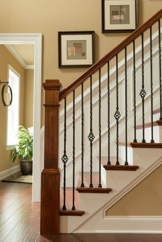 This is our staircase railing. Craftsman Staircase with High ceiling, Wainscotting, Chair rail, Hardwood floors Stairway Railing Ideas, Staircase Railings, Staircase Design, Banisters, Staircases, Bannister Ideas, Handrail Ideas, Iron Spindle Staircase, Staircase Pictures