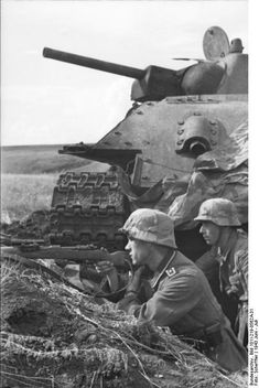 German soldiers in position near a destroyed Russian T-34 tank. South Russia 1943