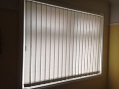 Vertical blinds with a wand for child safety, Wrexham. http://blindswrexham.co.uk