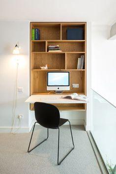 Fold-down work station inc plug socket, but NB PC, not lappie. Open shelf beneath.