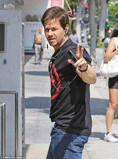 Mark Wahlberg flashes peace sign as brother Donnie gets engaged to Jenny McCarthy | Mail Online