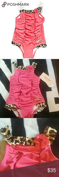 Juicy Couture One Piece Swimsuit Ruched one piece swimsuit size 6-9 months. Leopard print ruffles and ruching details. Dual ruffle straps with floral neckline detail. Elastic leg openings and lined. Simply the cutest thing ever! Juicy Couture Swim