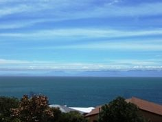 Majestic mountain behind and views stretching across the ocean to the Hottentots Holland Mountain range. Price negotiable.