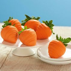 LOVE THIS!! Dip strawberries in white chocolate that's tinted with orange food coloring for a carrot-inspired treat! #ediblecrafts