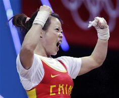 Pumped Up!! Wang Mingjuan of China won the first gold medal of the 2012 Olympics weightlifting competition, taking the women's 48-kilogram title Saturday with a total weight of 205 kilograms.